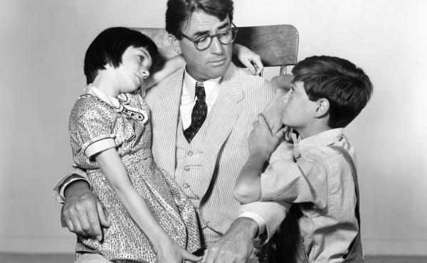 "It was recently announced that Aaron Sorkin will be adapting To Kill A Mockingbird for Broadway. Above, Scout's legs are tired after a particularly long ""walk and talk."" (Not really.) Above, Gregory Peck as Atticus Finch with Mary Badham as Scout and Phil"