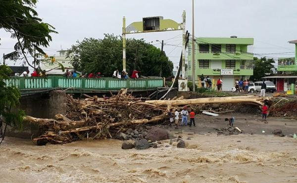 Rivers remained swollen and choked with debris in Roseau, Dominica, on Friday after Tropical Storm Erika had passed