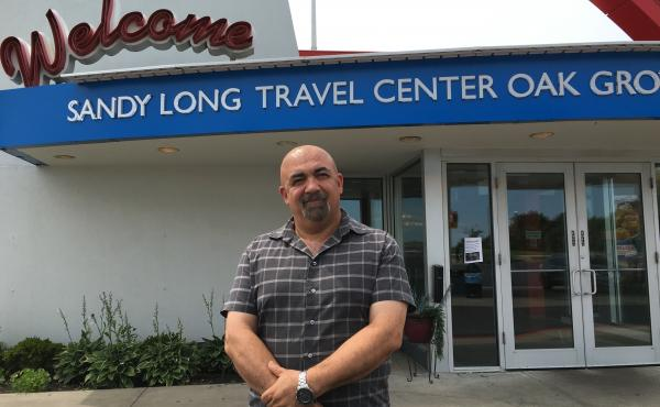 Sam Tahour, district manager for Travel Centers of America, stands next to a travel plaza outside Kansas City. Tahour was trained by a new effort to identify and stop sex trafficking at truck stops.