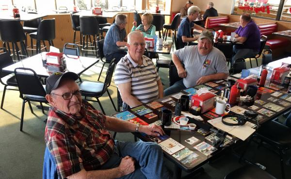 Dave Cover (left), Doyle Smithson (center) and Rob Freeman meet weekday mornings at the Top Notch Diner in Cortland, Ohio. All three voted for President Trump.