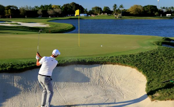Adam Scott of Australia plays during the World Golf Championships-Cadillac Championship at the Trump National Doral Blue Monster course in 2016.