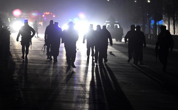 Afghan security personnel arrive at the site of two bombs on Tuesday near the Afghan parliament in Kabul.