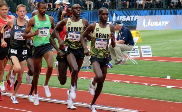 Two members of the U.S. Army lead the pack in the 5,000 meters at the U.S. Olympic Trials in July in Eugene, Ore. Shadrack Kipchirchir (right), did not make the team in the 5,000, but did qualify in the 10,000. Paul Chelimo (second from right), qualified