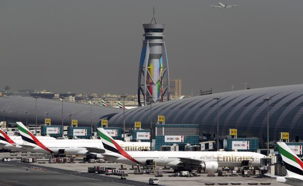 Emirates passenger planes are parked at their gates at Dubai International Airport in the United Arab Emirates. The U.S. restrictions require most electronic devices, including laptops, tablets and cameras, to be placed in checked baggage on direct flight