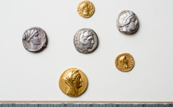Coins from the Thomas Lockwood Collection were recently found to be rare and priceless. From a description by the University at Buffalo, from top to bottom: A gold aureus of the Roman emperor Otho; a tetradrachm of Athens; a tetradrachm of Alexander the G