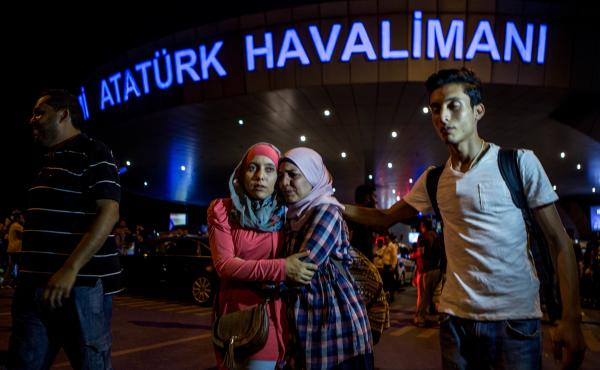 Passengers leave Istanbul Ataturk, Turkey's largest airport, after a suicide bomb attack Tuesday killed at least 42 people and wounded more than 230 people.
