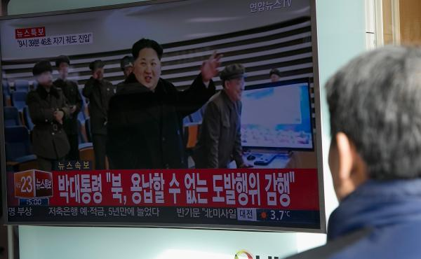 People watch a television screen showing news of North Korea's long-range rocket launch on Feb. 7 in Seoul. The new proposed U.N. resolution would ban supplying North Korea with aviation fuel, including rocket fuel.