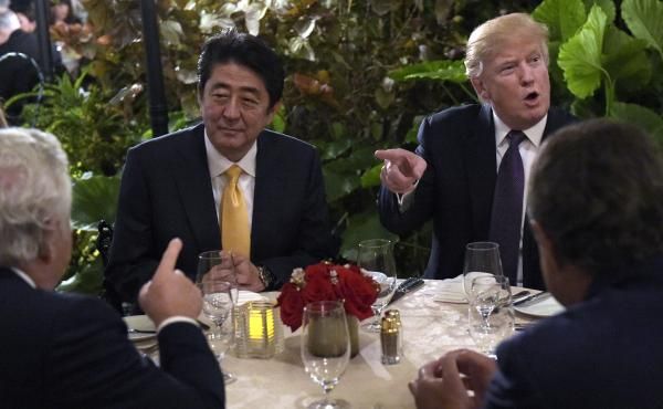 President Trump hosts Japanese Prime Minister Shinzo Abe at Mar-a-Lago in Palm Beach, Fla., on Feb. 10. North Korea tested a missile during Abe's visit last weekend, one of several provocative actions by U.S. rivals during the first month of Trump's presi