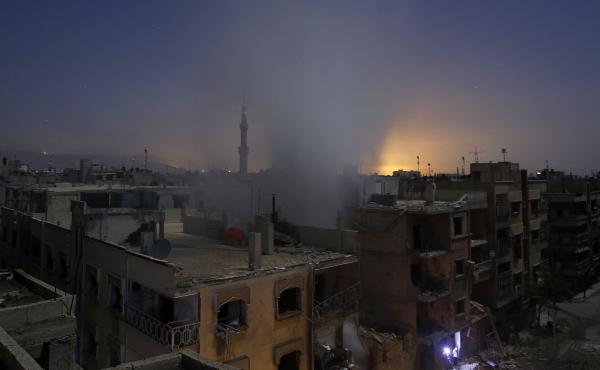 The U.S. plans to send up to 50 members of its Special Operations Forces to Syria to help fight ISIS. They'll be entering a war zone with many combatants. Here, smoke rises from a building in the rebel-controlled area of Douma, east of Damascus, early Fri