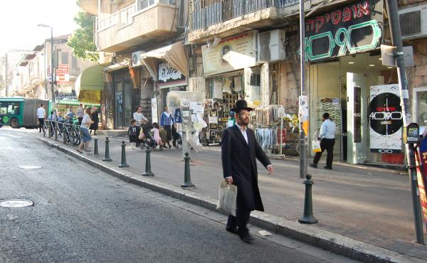 In the ultra-Orthodox Jewish neighborhood of Mea Sharim, men wear dark pants, long dark coats and black hats.