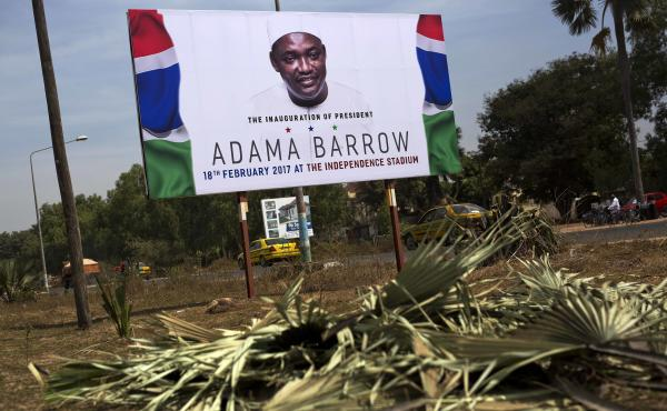 A billboard calling for the inauguration of Adama Barrow as president on the side of a road last month in Serrukunda, Gambia.