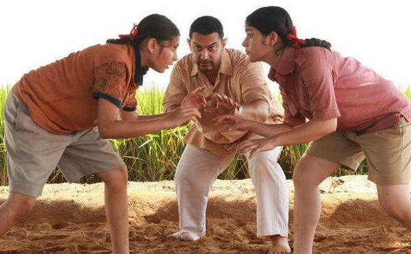 Actor Aamir Khan plays former wrestler Mahavir Singh Phogat, training his on-screen daughters in the art of wrestling, in the film Dangal.