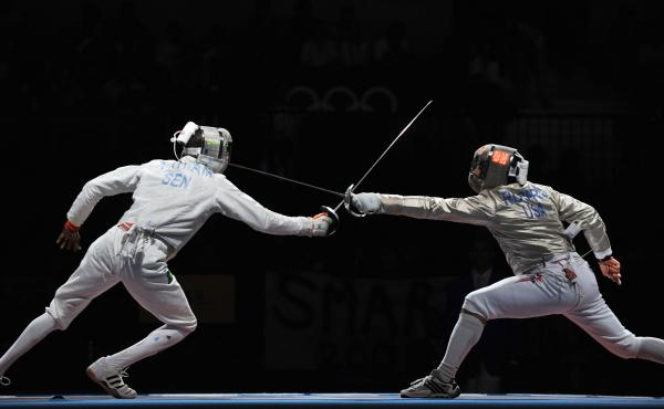 Senegalese fencer Abdoulaye Thiam (left) competed against Jason Rogers of the U.S. during the 2008 Olympics. Due to Ebola fears, a World Cup fencing event set for Senegal this month has been canceled.