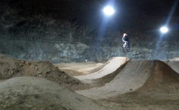 A rider gets some air at the newly opened Mega Underground Bike Park in Louisville, Ky.