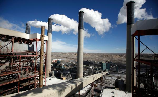 Steam rises from the stacks of the coal-fired Jim Bridger Power Plant outside Point of the Rocks, Wyo., in March 2014.