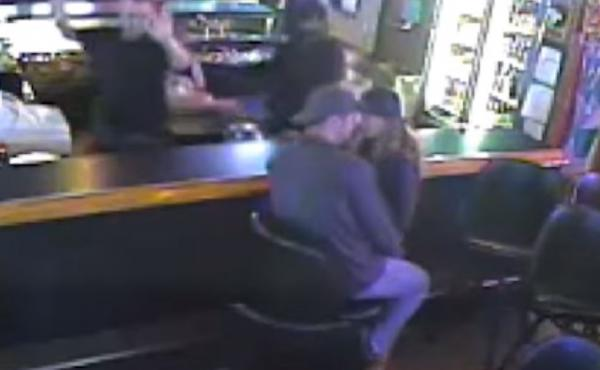 Security footage shows the couple kissing through the holdup Monday in Billings, Mont.