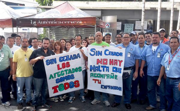 Furloughed Polar workers picket outside Polar's Caracas brewery, which shut down in April. They are protesting against the government, which has impeded Polar's ability to import barley.
