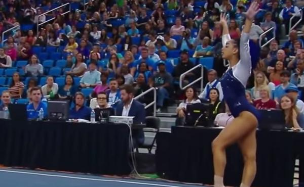 Sophina DeJesus, a gymnast for UCLA, performs a floor routine.