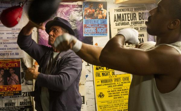 Sylvester Stallone as Rocky Balboa and Michael B. Jordan as Adonis Johnson in a scene from Creed.
