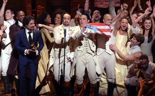 Music director Alex Lacamoire and actor/composer Lin-Manuel Miranda celebrate onstage during a Hamilton performance for the Grammy Awards at Richard Rodgers Theater in New York on Feb. 15.