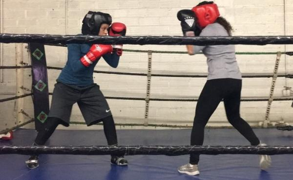 16-year-old Amaiya Zafar (left) spars in the Circle of Disclipline gym in Minneapolis earlier this month. USA Boxing has granted Zafar a religious exemption to fight in one bout while wearing hijab.