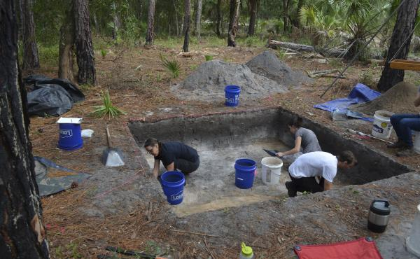 """Rachelle Ianelli (left) and Austin Jacobs (middle) both archaeological students from University of Florida, together with Florida Public Archaeology Network representative Rachael Kangas, excavate a section at """"Garden Patch,"""" a settlement populated after"""
