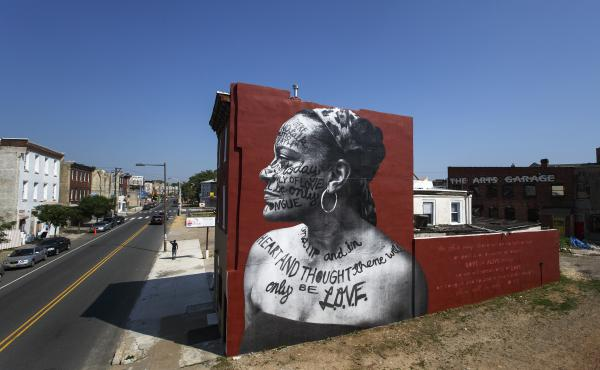 A Philadelphia mural titled You Go Girl by Jetsonorama and Ursula Rucker. This is just one of many murals that the city's Mural Arts Program helped create.