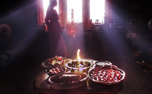 The bounty of the earth is celebrated in the high rituals of pagans. (Above) A Wiccan priestess is silhouetted by the afternoon light. In the foreground are examples of Wiccan cooking for the vernal equinox: (clockwise from near right) beet-pickled eggs;