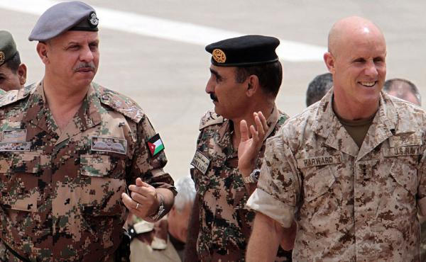 Then-deputy director of CENTCOM, U.S. Navy Vice Admiral Robert Harward, is pictured with  Jordan's Prince Faisal and the Army's head of operations and training Major General Awni Adwan in a May 2012 photo. Harward is now under consideration to replace Mic