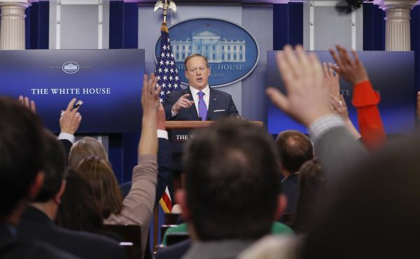 White House Press secretary Sean Spicer takes questions from the media on Tuesday. He said it was President Trump's decision to have national security adviser Michael Flynn resign.