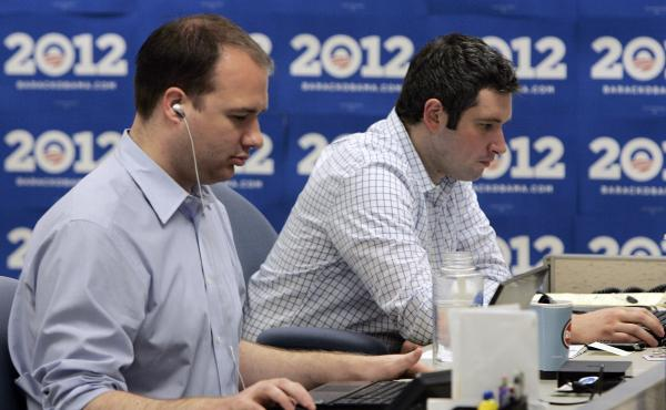 A quick staff-up and a fast-paced money grab are common to both startups and campaigns. Here, staffers work at computers during a tour of President Obama's re-election headquarters in Chicago on May 12, 2010.