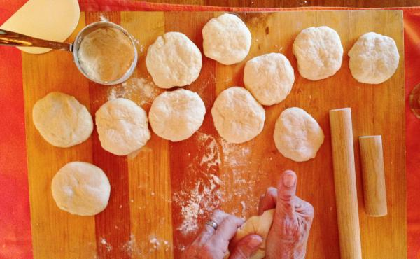 Janet Stein Romero of El Ancon, N.M., shapes the dough before rolling out flour tortillas.