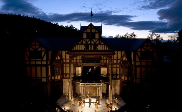 The Oregon Shakespeare Festival's Elizabethan Theatre — shown above during a production of Henry V in 2012 — seats 1,200 people under the open sky. With wildfires raging in Washington state, the festival has installed air quality monitors for the safe