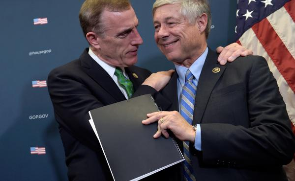 Rep. Tim Murphy, R-Pa., embraces Rep. Fred Upton, R-Mich., during a media briefing about the 21st Century Cures Act on Capitol Hill Wednesday.