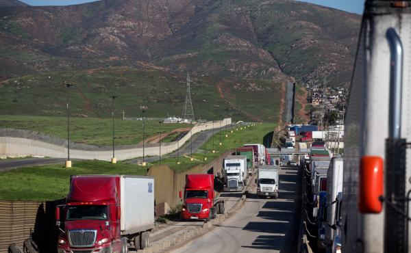 Trucks line up to cross to the United States near the Otay Commercial port of entry on the Mexican side of the U.S.-Mexico border on Jan. 25. Trump now says he will renegotiate the North American Free Trade Agreement, which he has long criticized, rather