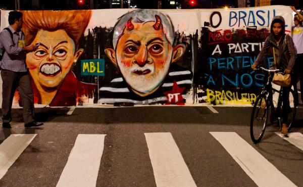Protesters last month vent their anger over President Dilma Rousseff (left) moving to appoint her predecessor, Luis Inacio Lula da Silva, as her chief of staff — an action that would have shielded him from prosecution. A court blocked him from the post.