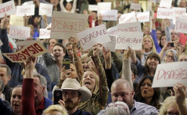 People react to Rep. Jason Chaffetz as he speaks during a town hall meeting at Brighton High School in Utah last week.