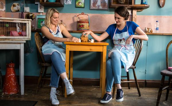 In the show, Fleabag (Phoebe Waller-Bridge, right) copes with the death of her best friend, Boo (Jenny Rainsford). Before Boo died, the two ran a guinea pig-themed cafe together.