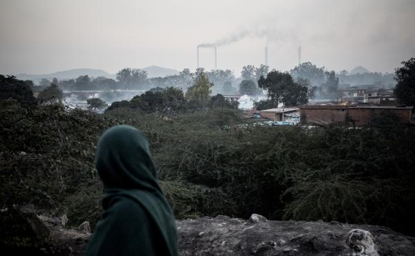 Smoke rises from chimneys of coal-based power plants in the Sonbhadra District of Uttar Pradesh, India.