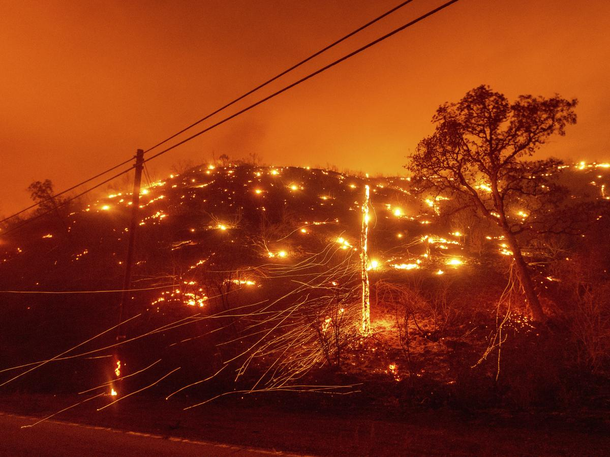 Embers burn along a hillside as the LNU Lightning Complex fires tear through unincorporated Napa County, Calif., on Tuesday. Fire crews across the region scrambled to contain dozens of wildfires sparked by lightning strikes as a statewide heat wave contin