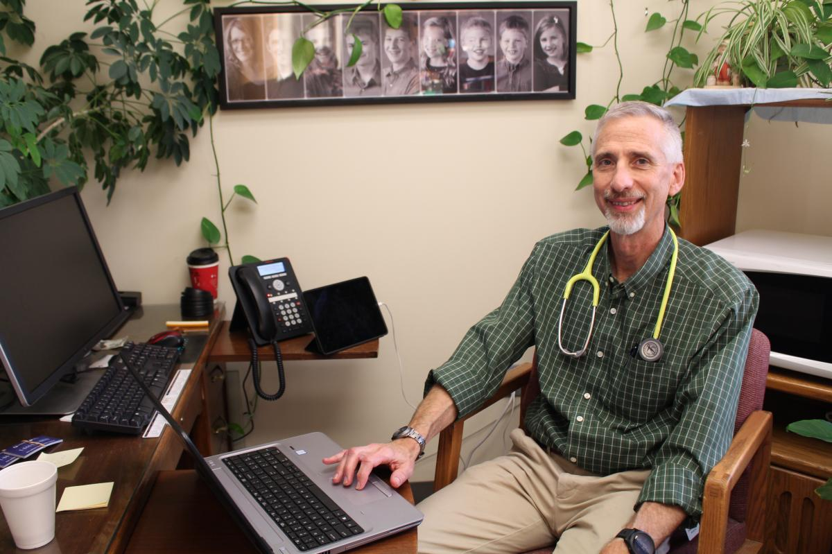 """For months after Mercy Hospital Fort Scott closed, patients couldn't as quickly get appointments with Dr. Max Self. """"I don't like to hear that,"""" Self says. His new employer, Community Health Center of Southeast Kansas, assigned him a medical scribe to hel"""