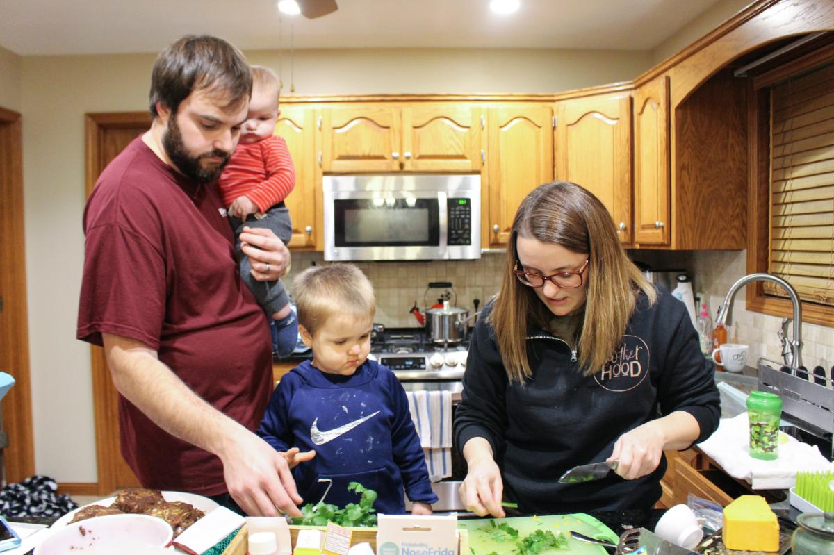 Dietitian Sherise Beckham cooks dinner with her family — husband Tanner, 8-month-old Barrett and 2-year-old Warren. Non-routine childbirths are trickier than they were before the hospital closure, as the family learned firsthand: Beckham needed a cesare