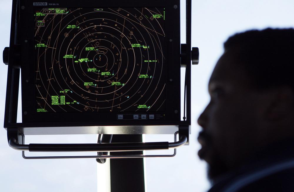 Air traffic controller Karl Haynes Jr. watches the radar screen at Washington's Reagan National Airport. For more than a decade, the FAA has been working on a new radar system that is more precise and would allow more flights, closer together.