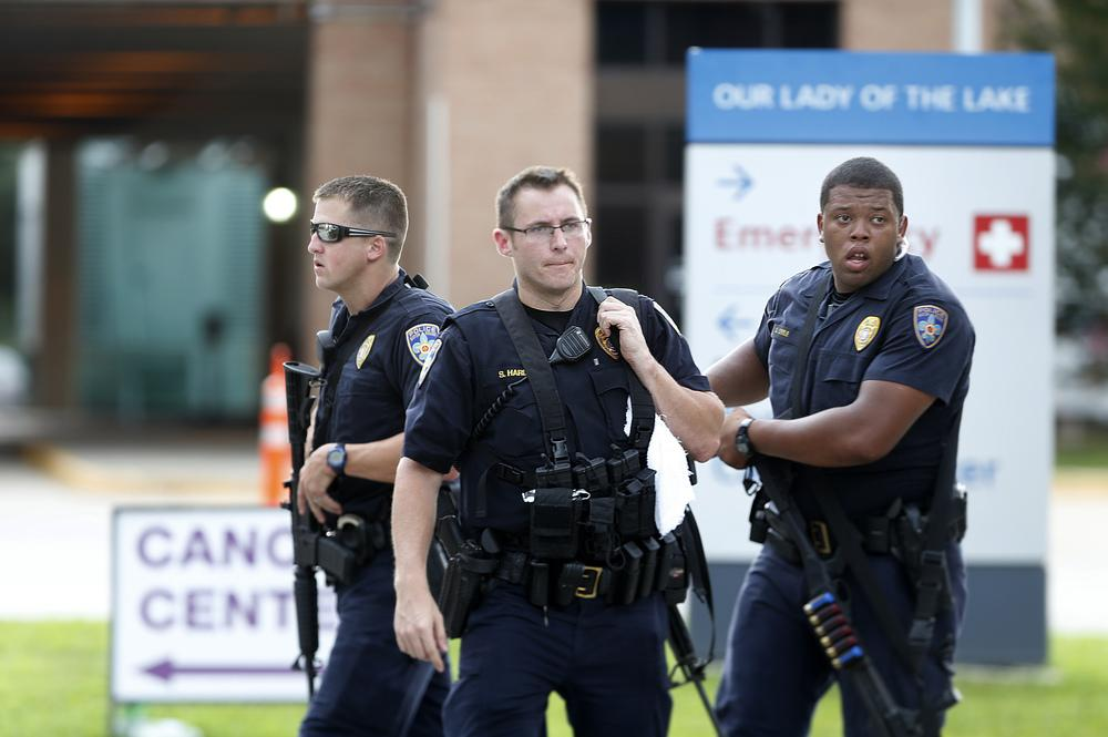 Police guard the emergency room entrance of Our Lady Of The Lake Medical Center, where wounded officers were brought on Sunday in Baton Rouge, La.