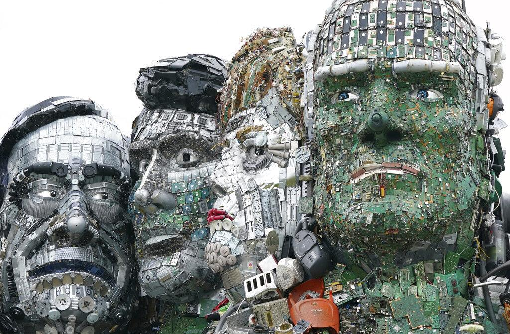 (From left) Italy's Mario Draghi, Canada's Justin Trudeau, Germany's Angela Merkel and Joe Biden of the U.S. are among the seven leaders depicted in Mount Recyclemore, created by artists Joe Rush and Alex Wreckage.