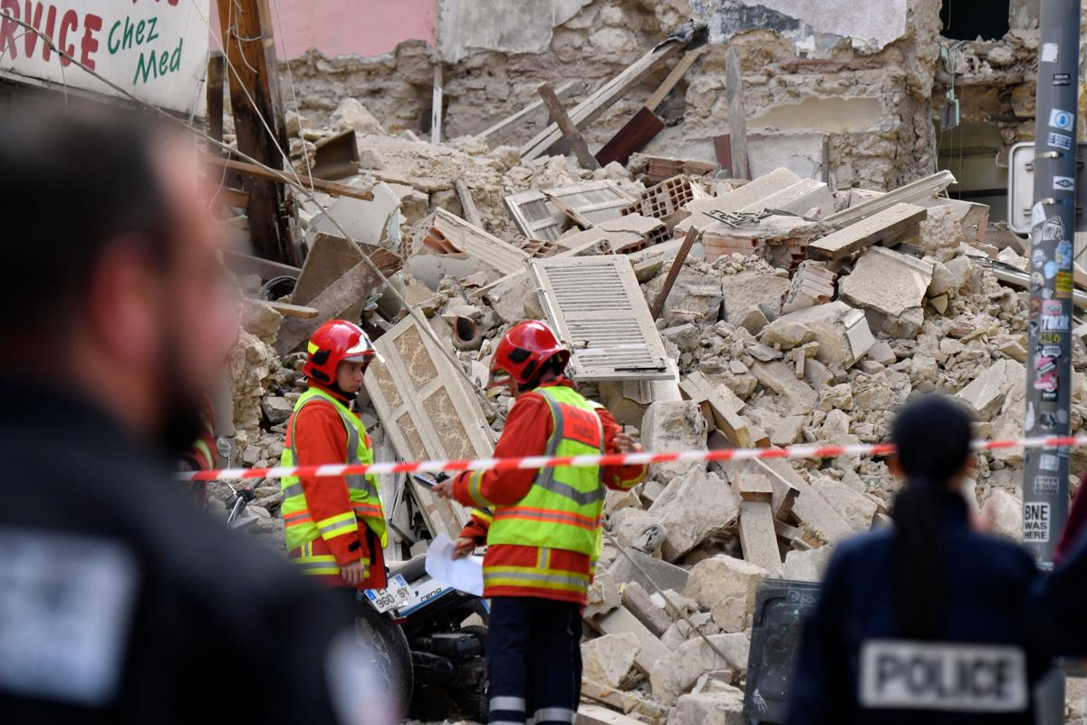 Firefighters and police work at the site near Marseille's Old Port where two buildings collapsed on Monday.