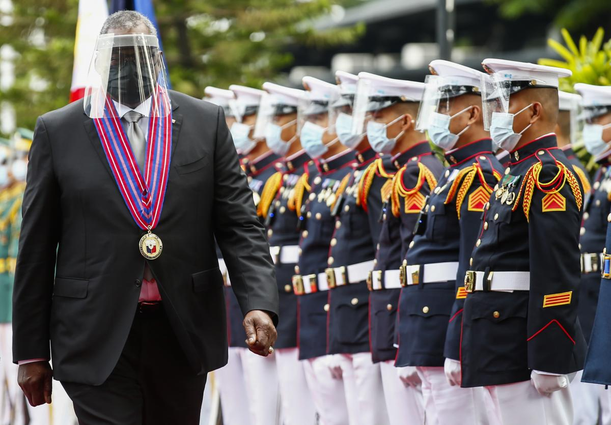 U.S. Defense Secretary Lloyd Austin views the Philippine military honor guard at Camp Aguinaldo in Quezon City, Philippines, on July 30.