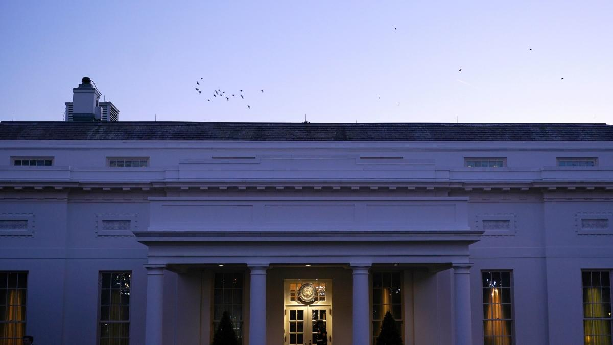 A Marine guards the West Wing of the White House on Wednesday.