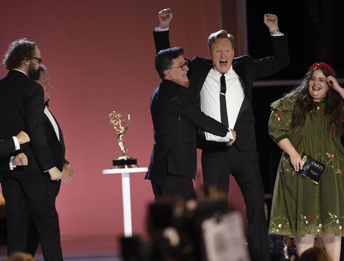 """Conan O'Brien, right, congratulates Stephen T. Colbert for his Emmy win for outstanding variety special (live) for """"Stephen Colbert's Election Night 2020: Democracy's Last Stand Building Back America Great Again Better 2020."""""""