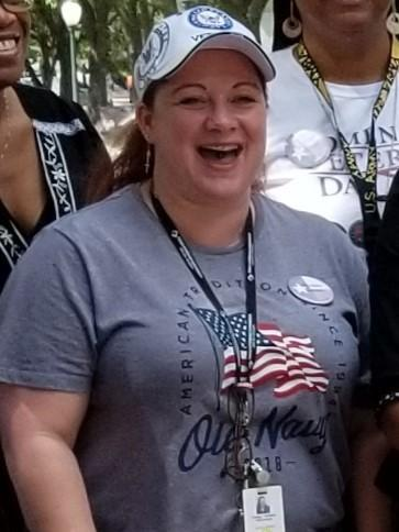 Chasity Wohlford, a Navy veteran in Houston, says a payday lender charged her nearly three times what she borrowed in just eight months. She is pictured taking part in Women Veteran's Day in Austin, Texas, last June.